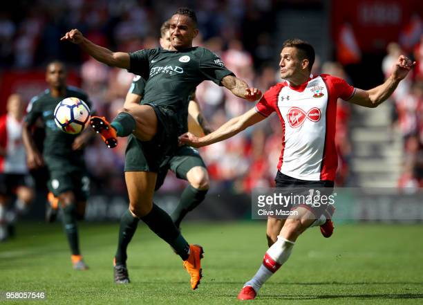 Danilo of Manchester City controls the ball as Dusan Tadic of Southampton looks on during the Premier League match between Southampton and Manchester...