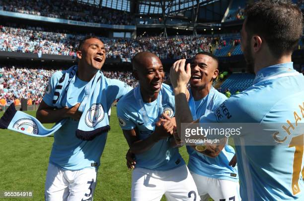 Danilo of Manchester City Fernandinho of Manchester City and Gabriel Jesus of Manchester City celebrate victory after the Premier League match...