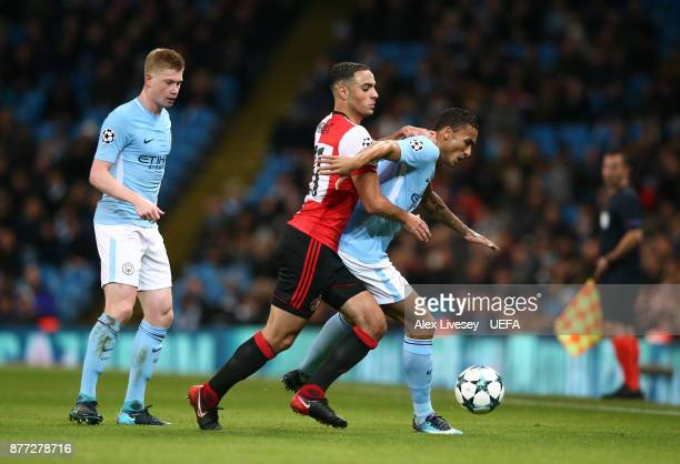 Danilo of Manchester City holds off a challenge from Sofyan Amrabat of Feyenoord during the UEFA Champions League group F match between Manchester...