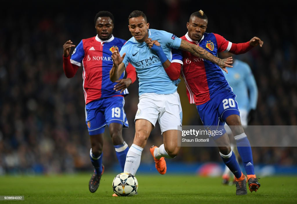 Danilo of Manchester City holds off pressure from Geoffroy Serey Die of FC Basel during the UEFA Champions League Round of 16 Second Leg match between Manchester City and FC Basel at Etihad Stadium on March 7, 2018 in Manchester, United Kingdom.