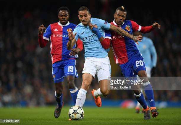 Danilo of Manchester City holds off pressure from Geoffroy Serey Die of FC Basel during the UEFA Champions League Round of 16 Second Leg match...