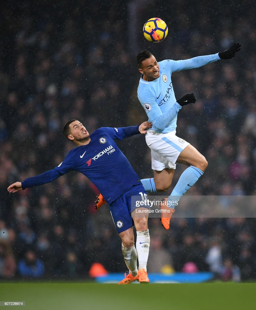 Danilo of Manchester City rises for the ball ahead of Eden Hazard of Chelsea during the Premier League match between Manchester City and Chelsea at Etihad Stadium on March 4, 2018 in Manchester, England.