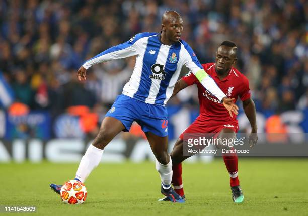 Danilo of Porto holds off a challenge from Sadio Mane of Liverpool during the UEFA Champions League Quarter Final first leg match between Liverpool...