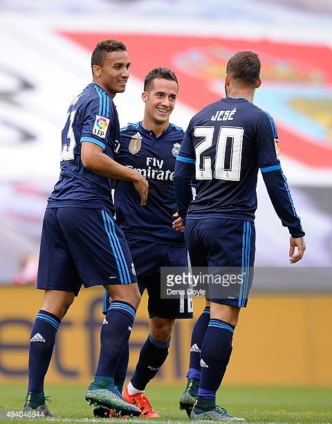 Danilo of Real Madrid celebrates with Lucas Vazquez and Jesse Rodriguez after scoring his team's 2nd goal during the La Liga match between Celta Vigo...