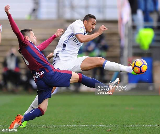 Danilo of Real Madrid CF clears the ball from Ruben Pena SD Eibar of during the La Liga match between SD Eibar and Real Madrid CF at Estadio...