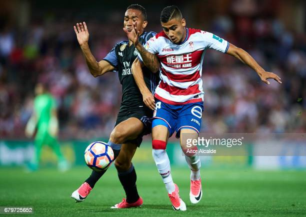 Danilo of Real Madrid CF competes for the ball with Andreas Pereira of Granada CF ¼during the La Liga match between Granada CF v Real Madrid CF at...