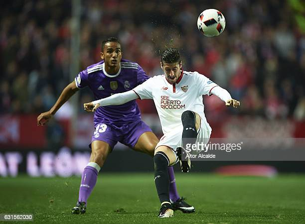 Danilo of Real Madrid CF competes for the ball with Sergio Escudero of Sevilla FC during the Copa del Rey Round of 16 Second Leg match between...
