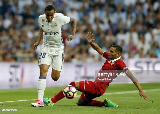 Danilo of Real Madrid competes for the ball with Gabriel Mercado of Sevilla FC during the La Liga match between Real Madrid and Sevilla FC at Estadio...
