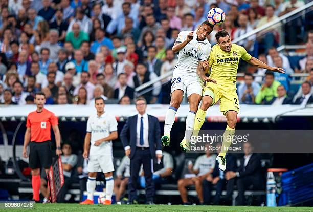 Danilo of Real Madrid competes for the ball with Mario Gaspar of Villarreal during the La Liga match between Real Madrid CF and Villarreal CF at...