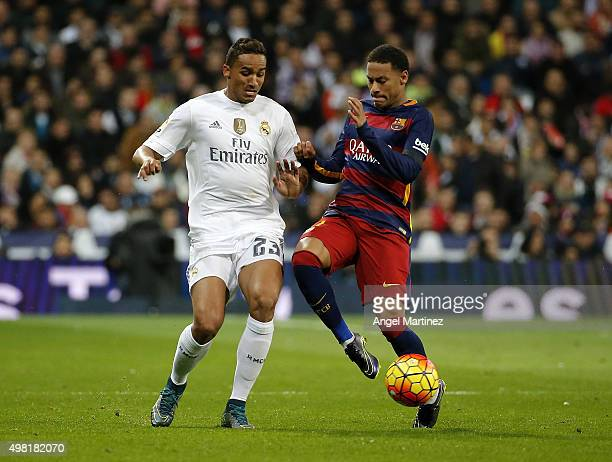 Danilo of Real Madrid competes for the ball with Neymar of FC Barcelona during the La Liga match between Real Madrid CF and FC Barcelona at Estadio...