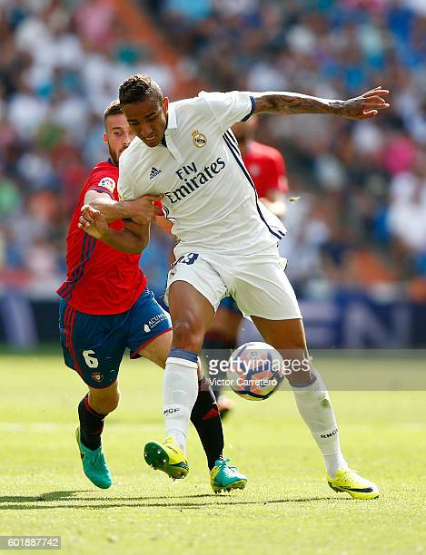 Danilo of Real Madrid competes for the ball with Oier Sanjurjo of Osasuna during the La Liga match between Real Madrid CF and CA Osasuna at Estadio...