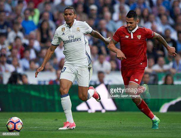 Danilo of Real Madrid competes for the ball with Vitolo of Sevilla during the La Liga match between Real Madrid CF and Sevilla CF at Estadio Santiago...
