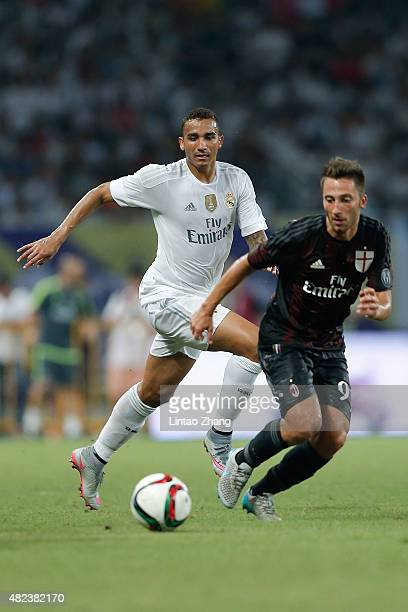 Danilo of Real Madrid contests the ball against Andrea bertolacci of AC Milan during the International Champions Cup match between Real Madrid and AC...