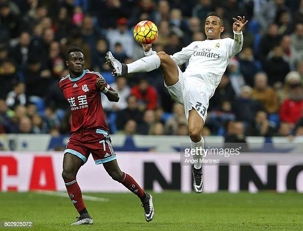 Danilo of Real Madrid controls the ball under pressure from Bruma of Real Sociedad during the La Liga match between Real Madrid CF and Real Sociedad...