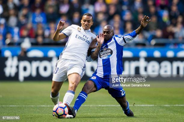 Danilo of Real Madrid duels for the ball with Gael Kakuta of RC Deportivo La Coruna during the La Liga match between RC Deportivo La Coruna and Real...