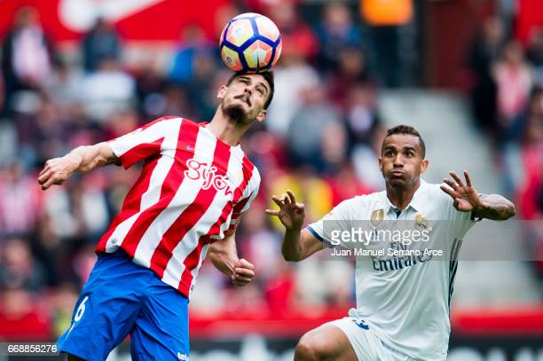 Danilo of Real Madrid duels for the ball with Sergio Alvarez of Real Sporting de Gijon during the La Liga match between Real Sporting de Gijon and...