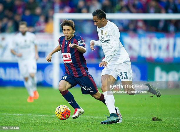 Danilo of Real Madrid duels for the ball with Takashi Inui of SD Eibar during the La Liga match between SD Eibar and Real Madrid at Ipurua Municipal...