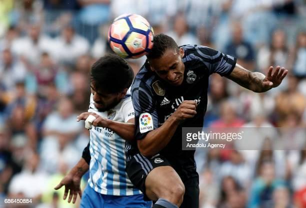 Danilo of Real Madrid in action against Recio del Pozo of Malaga during the La Liga match between Malaga and Real Madrid at La Rosaleda Stadium on...