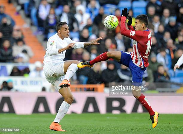 Danilo of Real Madrid is tackled by Angel Correa of Club Atletico de Madrid during the La Liga match between Real Madrid CF and Club Atletico de...