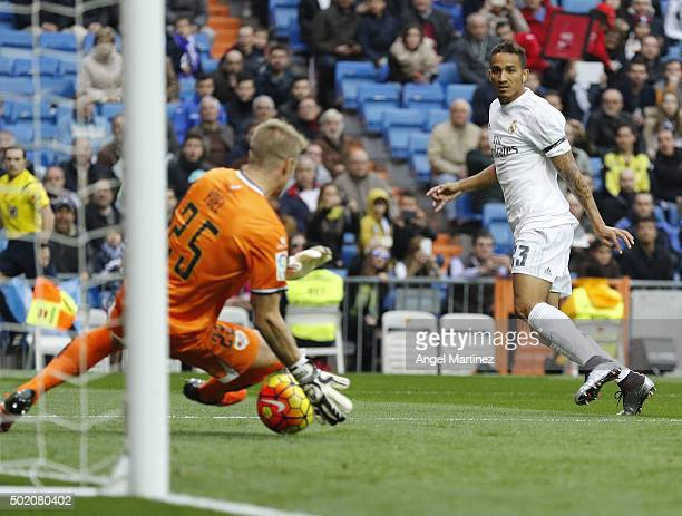 Danilo of Real Madrid scores the opening goal past Yoel Rodriguez of Rayo Vallecano during the La Liga match between Real Madrid CF and Rayo...
