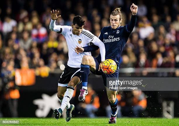Danilo of Valencia CF competes for the ball with Gareth Bale of Real Madrid CF during the Valencia CF vs Real Madrid CF as part of the Liga BBVA...