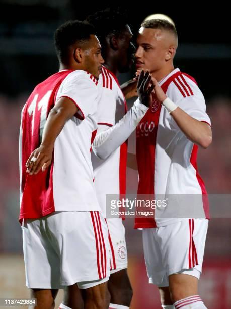Danilo Pereira Da Silva of Ajax U23 celebrates 52 with Noa Lang of Ajax U23 Lassina Traore of Ajax U23 during the Dutch Keuken Kampioen Divisie match...