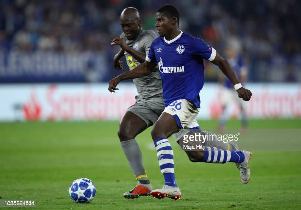 Danilo Pereira of FC Porto battles for possession with Salif Sané of FC Schalke 04 during the Group D match of the UEFA Champions League between FC...