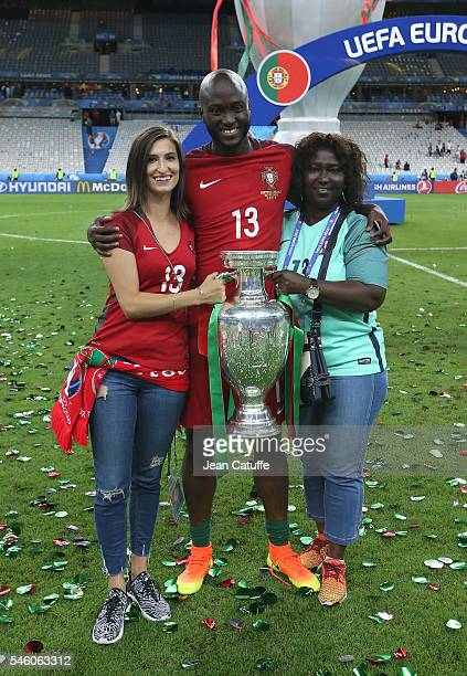 Danilo Pereira of Portugal poses with the trophy following the UEFA Euro 2016 final match between Portugal and France at Stade de France on July 10...