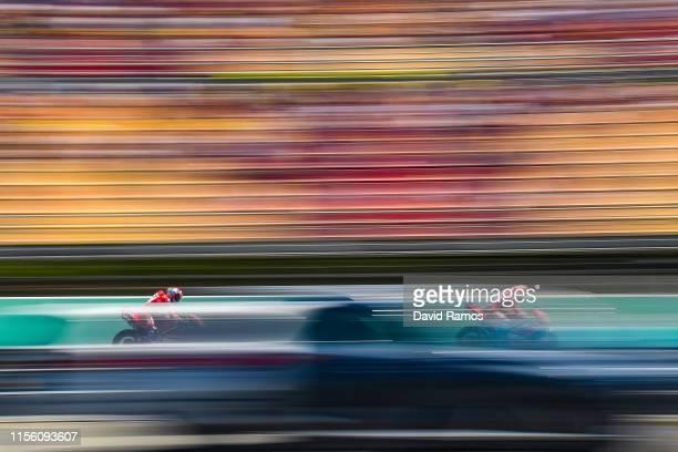 Danilo Petrucci and Andrea Dovizioso of Italy and Mission Winnow Ducati ride during the fourth MotoGP free practice session ahead of MotoGP Gran...