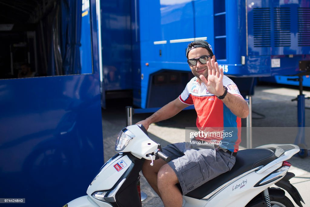 Danilo Petrucci of Italy and Alma Pramac Racing greets in paddock in scooter during the MotoGp of Catalunya - Previews at Circuit de Catalunya on June 14, 2018 in Montmelo, Spain.