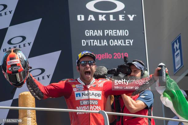 Danilo Petrucci of Italy and Ducati Team celebrates his first victory on the podium at the end of the MotoGP race during the MotoGp of Italy Race at...