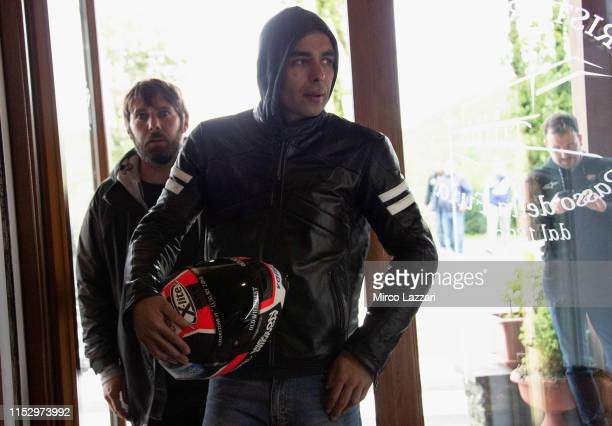 """Danilo Petrucci of Italy and Ducati Team enters in restaurant """"Passo della Futa"""" during the MotoGp of Italy - Filming Day at Mugello Circuit on May..."""