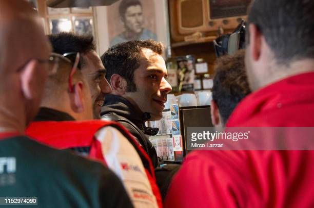 Danilo Petrucci of Italy and Ducati Team smiles with Ducati fans in restaurant Passo della Futa during the MotoGp of Italy Filming Day at Mugello...