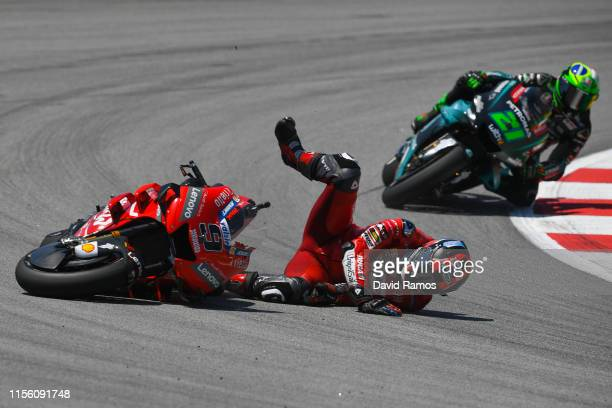 Danilo Petrucci of Italy and Mission Winnow Ducati crashes during the MotoGP Qualifying ahead of MotoGP Gran Premi Monster Energy de Catalunya at...