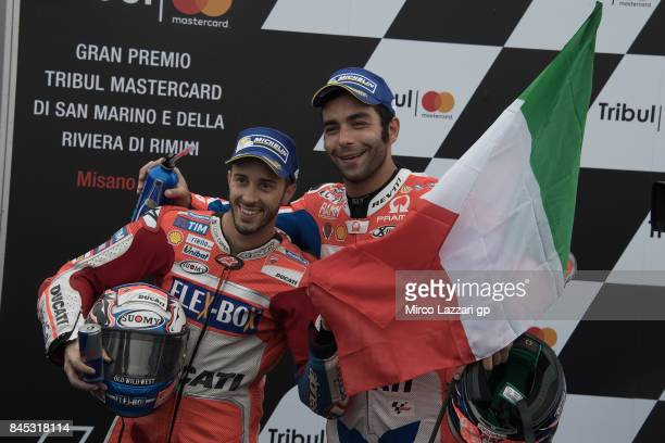 Danilo Petrucci of Italy and Octo Pramac Yakhnich and Andrea Dovizioso of Italy and Ducati Team celebrate under the podium at the end of the MotoGP...