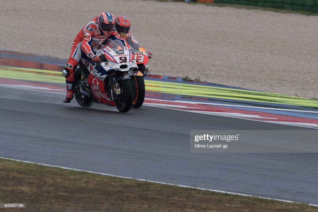 Danilo Petrucci of Italy and Octo Pramac Yakhnich leads Marc Marquez of Spain and Repsol Honda Team during the MotoGP Race during the MotoGP of San Marino - Race at Misano World Circuit on September 10, 2017 in Misano Adriatico, Italy.