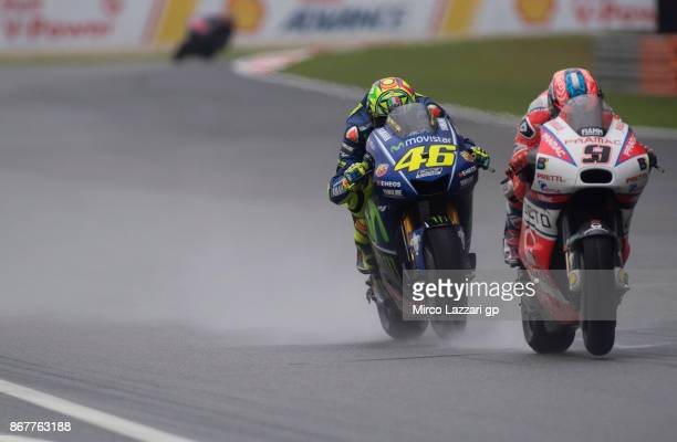 Danilo Petrucci of Italy and Octo Pramac Yakhnich leads Valentino Rossi of Italy and Movistar Yamaha MotoGP during the MotoGP race during the MotoGP...