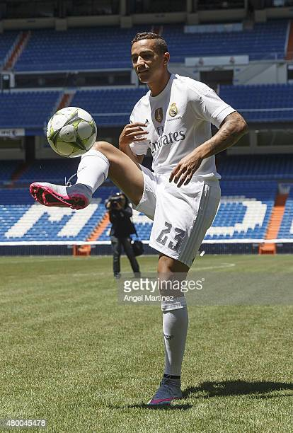 Danilo plays with the ball during his official presentation as a new Real Madrid player at Estadio Santiago Bernabeu on July 9 2015 in Madrid Spain
