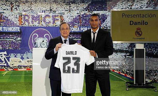 Danilo poses with Real Madrid president Florentino Perez during his official presentation as a new Real Madrid player at Estadio Santiago Bernabeu on...
