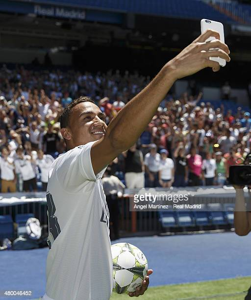 Danilo takes a selfie during his official presentation as a new Real Madrid player at Estadio Santiago Bernabeu on July 9 2015 in Madrid Spain