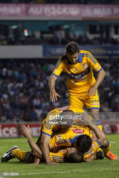 Danilo Veron of Tigres celebrates after scoring during a match between Queretaro and Tigres as part of the Clausura 2013 Copa MX at Corregidora...