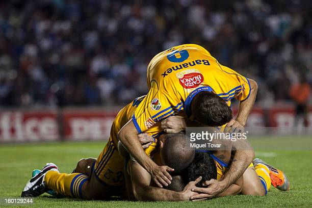 Danilo Veron of Tigres celebrates after scoring with teammates during a match between Queretaro and Tigres as part of the Clausura 2013 Copa MX at...