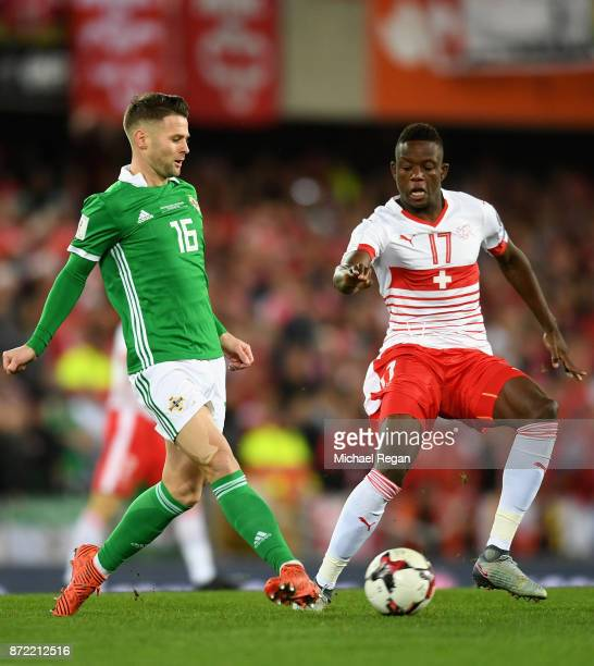 Danis Zakaria of Switzerland closes down Oliver Norwood of Northern Ireland during the FIFA 2018 World Cup Qualifier PlayOff First Leg between...