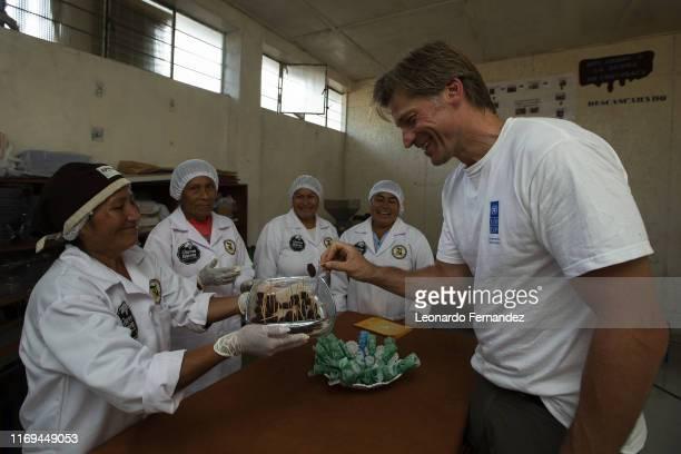 Danish actor and United Nations Development Programme Goodwill Ambassador Nikolaj CosterWaldau takes a chocolate made by Yanesha women members of the...