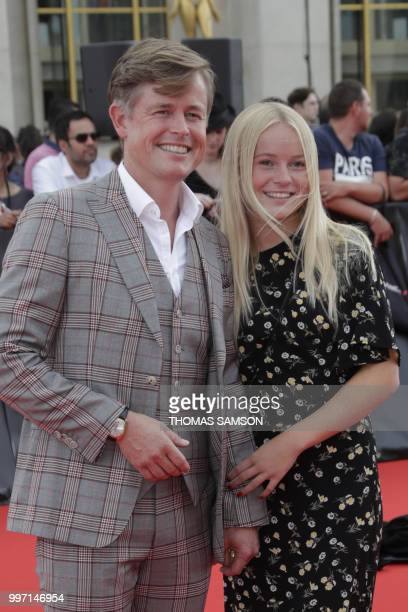 Danish actor Caspar Phillipson poses on the red carpet as he arrives to attend the world premiere of his new film Mission Impossible Fallout on July...
