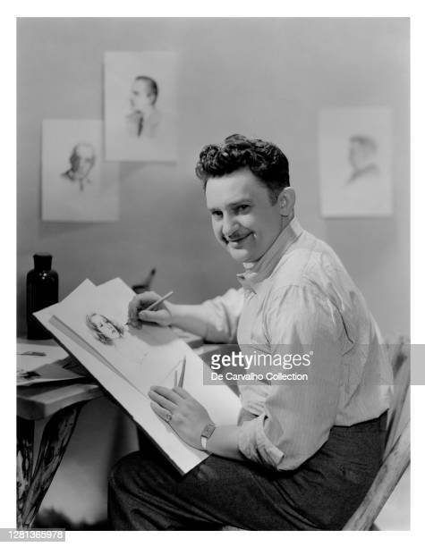 Danish Actor Jean Hersholt shows his talent as an artist in making a sketch of Swedish Actress Greta Garbo, with images of actors Lewis Stone, John...