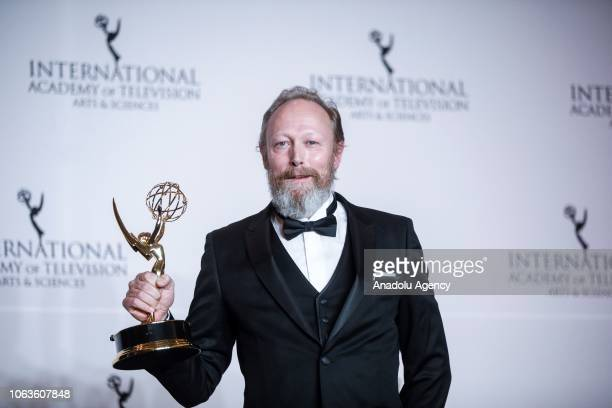Danish actor Lars Mikkelsen gives a pose with the award during the 46th International Emmy Awards at New York Hilton on November 19 2018 in New York...