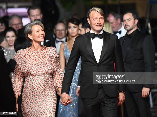 Danish actor Mads Mikkelsen and his wife Hanne Jacobsen arrive on May 11 2018 for the screening of the film Arctic at the 71st edition of the Cannes...