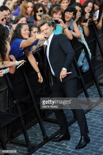 Danish actor Nikolaj CosterWaldau who plays the character of Jaime Lannister in Game of Thrones poses for a selfie with fans as he signs autographs...