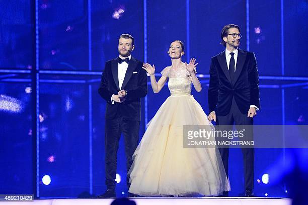 Danish actor Pilou Asbaek TV hosts Lise Roenne and Nikolaj Koppel stand on stage during the Eurovision Song Contest 2014 Grand Final in Copenhagen...